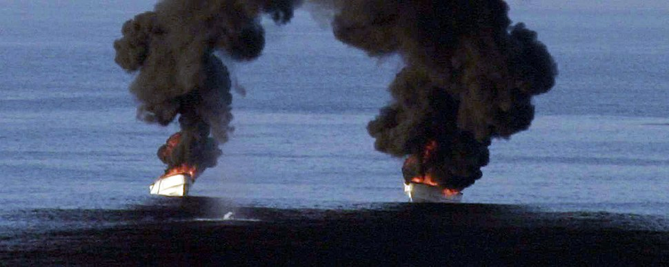 US Navy 110202-N-2907P-001 Suspected pirate skiffs burn from weapons fire from the guided-missile destroyer USS Momsen (DDG 92)