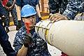US Navy 110812-N-DX615-005 Aviation Ordnanceman 2nd Class Jorge Carino loads a GBU-38 joint direct attack munitions (JDAM) 500-pound bomb aboard th.jpg