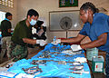US Navy 111022-N-VP123-059 Hospital Corpsman 2nd Class Rochelle Quintyne, assigned to Commander, Task Force 73, passes sterile instruments to a Roy.jpg