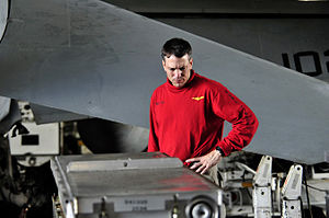US Navy 111222-N-ZI635-129 Cmdr. Paul C. Spedero, executive officer of the Nimitz-class aircraft carrier USS Carl Vinson (CVN 70) inspects ordnance.jpg