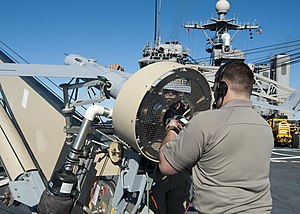 US Navy 120130-N-NR955-058 nsitu and Boeing contractors prepare the unmanned aerial vehicle Scan Eagle for a test flight from the flight deck aboar.jpg
