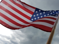 United States Flag with clouds.png