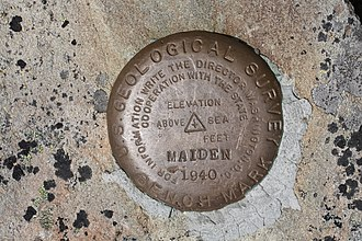 Survey marker - Marker for triangulation station, indicated by triangle in center