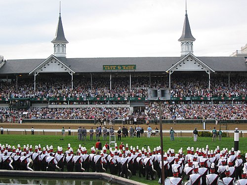Kentucky's Churchill Downs hosts the Kentucky Derby. University of Louisville marching band, Churchill Downs Twin Spires.jpg