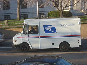 Mail carrier - A USPS van on Cambridge Street in Harvard Square (Cambridge, Massachusetts).