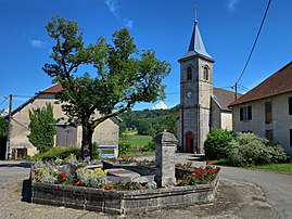 The church and water trough in Vaudrivillers