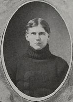 A young Sitton in a dark turtleneck