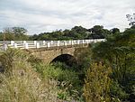 This bridge carries the Queen's Road, at that time an important military road, across the Kat River, It was designed by Major C. J. Selwyn, R.E., and completed towards the end of 1843 or early in 1844. Type of site: Bridge. Current use: Bridge.