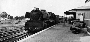 Parwan railway station - Victorian Railways R class locomotive R 730, hauling a Melbourne-Dimboola passenger service, at Parwan, 1953