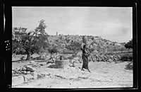 View of Bethlehem from the south. Woman leaving well, water jar on head LOC matpc.22402.jpg