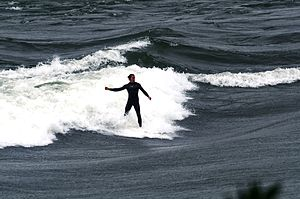 Surfing in Canada - Surfing the Habitat 67 standing wave, in the Lachine Rapids.