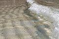 Water, light, sand abstract Iona (15250865115).jpg