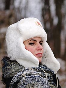 93989a3f4fd Woman using a Belarus parade ushanka as fashion wear