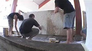 Parkour - Traceurs in Lisses re-painting a wall, repairing shoe scuff marks from parkour.
