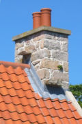 Witches' stones on tiled roof Jersey.jpg