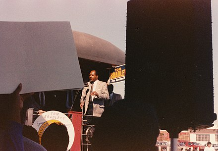 Bradley conducting a whistle stop appearance during his 1986 campaign Wod-o-Pics-3 0067 - Kodalux Processing Services NOV. 89 P - Bradley for Gov campaign whistle-stop 1986 (9501733131).jpg