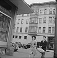 Woman in hat and young man pass corner tavern in Holyoke (October 1941).jpg