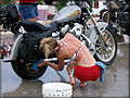 Young lady cleans a Harley.jpg