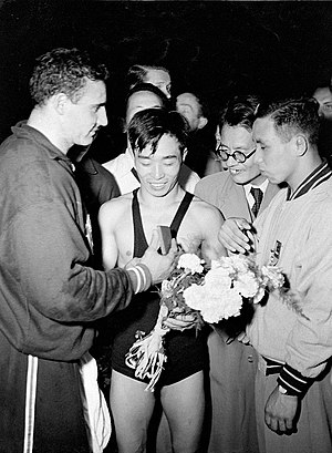 Yushu Kitano - Kitano (center) at the 1952 Olympics