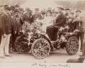 Yvonne Ravenez dite Mère Pouche driving a decorated Decauville car (before 15 June 1898).png