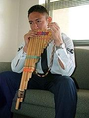 A Peruvian man playing the zampoña.