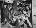 """Enlisted men aboard the U.S.S. Ticonderoga (CV-14) hear the news of Japan's surrender."", 08-14-1945 - NARA - 520868.tif"