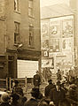 """Street scene with advertising hoardings"" but where? Corner of Summerhill and Langrishe Place! (9155805097).jpg"