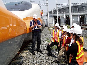 Eurotrain - A French driver and a French instructor demonstrate and explain train coupling to Taiwanese conductor trainees in September 2006.