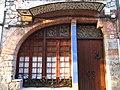 018 Casa al carrer de França, 22 (Sant Antoni de Vilamajor), detall dels baixos.jpg