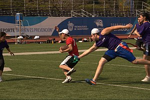 Flag football - Player at the point of taking other player's flag at a game at Monterrey Institute of Technology and Higher Education, Mexico City.