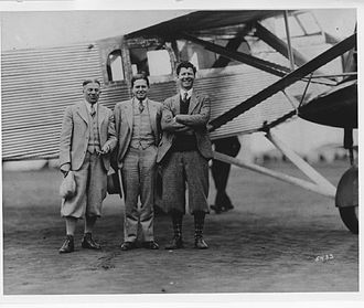 George H. Prudden - Ryan corp. group photo, left to right A.j. Edwards, F.W. Hemingway, George H. Prudden, standing in front of the Prudden TM-1 tri-motor airliner.
