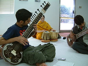 Usman Waqqas Chohan demonstrating at a sitar w...
