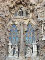 068 Sagrada Família, façana del Naixement, porta de la Caritat, Anunciació i cor d'àngels.jpg