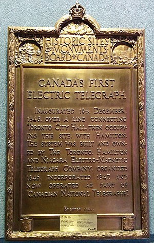 """Toronto Internet Exchange - Inaugurated 19th December 1846. Over a line connecting Toronto City Hall, then occupying this site.With Hamilton, the system was built and owned by the Toronto, Hamilton and Niagara Electro-Magnetic Telegraph Company. Organized in 1846, Incorporated 1847, and now operated as part of """"Canadian National Telegraphs""""."""