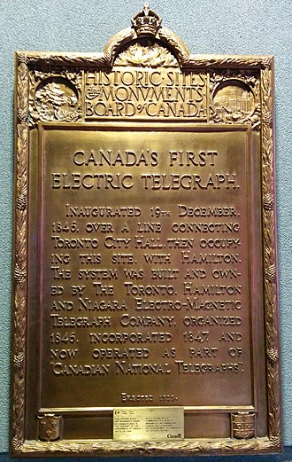 """Toronto Internet Exchange - Inaugurated 19 December 1846. Over a line connecting Toronto City Hall, then occupying this site.With Hamilton, the system was built and owned by the Toronto, Hamilton and Niagara Electro-Magnetic Telegraph Company. Organized in 1846, Incorporated 1847, and now operated as part of """"Canadian National Telegraphs""""."""