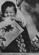 1940 govt photo minnesota farming scene chippewa baby teething on magazine indians at work
