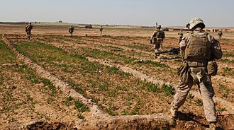 1st Battalion, 9th Marines - A team of infantry Marines with 3rd Platoon, Charlie Company, 1st Battalion, 9th Marine Regiment, patrols across a field during a security patrol in Helmand province, Afghanistan, 21 February 2014.