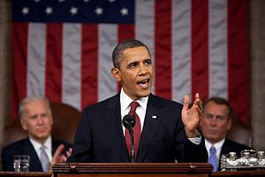 2012 State of the Union Address - President Barack Obama giving State of the Union Address, January 24, 2012. In the background, seated in their traditional posts when a Joint Session of Congress is held, are, at left, Vice Joe Biden and at right, House Speaker John Boehner.