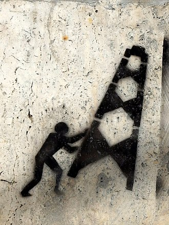 2012–14 Romanian protests against shale gas - Graffiti on a wall in Bucharest depicting a man tearing down a gas well, symbol of resistance against shale gas