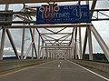 "2017-07-23 08 23 44 ""Ohio Welcomes You"" sign at the junction of West Virginia State Route 807 and Ohio State Route 807 (Hi Carpenter Memorial Bridge) crossing the Ohio River from Pleasants County, West Virginia to Washington County, Ohio.jpg"