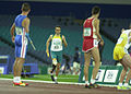 251000 - Athletics track 4 x 400m T46 Neil Fuller gold action - 3b - 2000 Sydney race photo.jpg