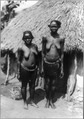 2 semi-nude Nubian women standing in front of hut, Africa LCCN2001705607.tif