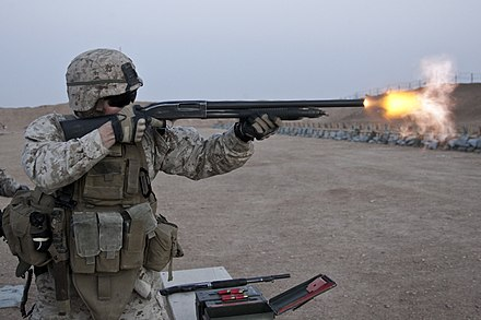 A United States Marine armed with a Mossberg 500 shotgun 3-7 Shooting Competition (Image 2 of 4) (12753731154).jpg