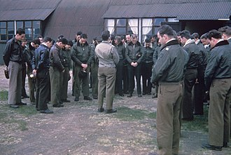 RAF East Wretham - Captain Wilbur C. Ziegler, station Chaplain, leads pilots of the 359th Fighter Group in prayer at East Wretham.