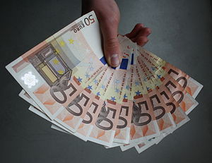 Euro banknotes - The 50 euro banknote has an orange colour scheme, and its gateway and bridge are from the Renaissance.