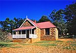This historic house stands on the western side of the main road between Ingogo and Charlestown. It is situated at the foot of the Amajuba Mountain, 35 kilometres from Newcastle and 11 km (7 mi) from Charlestown. It is planned in the form of a cross and is built… Type of site: House Previous use: house. Current use: museum. From Newcastle head north towards Volksrust on the R23. About 20 km (12 mi) from Newcastle and at the bottom. It was in this cottage that negotiations took place during a number of meetings in March 1881, …