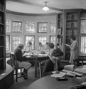 Queen Anne's School - A group of girls carry out some private study in the library of Queen Anne's School in 1945