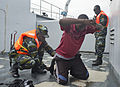 A Ugandan service member searches a simulated detainee aboard a target vessel during exercise Cutlass Express 2013 in the Gulf of Tadjoura off the coast of Djibouti Nov. 14, 2013 131114-F-NJ596-147.jpg