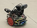 A robot developed entirely by the students from IIT Bombay, which can be remote-controlled by Aakash 2 tablet, on display before media at a media familiarization workshop on Aakash 2 (1).jpg