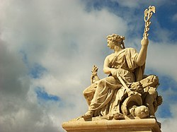 A sculpture at the entrance to the palace of Versailles.jpg